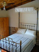 A traditional four poster bed is a feature of this lovely cottage in Ayia Anna in Cyprus