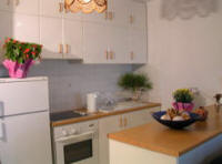 The kitchen in this studio flat at Governors beach in Cyprus is small but sufficient for a pleasant holiday experience