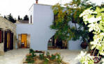 Garden Kamara House in Kato Drys - An agrotourism holiday house in Cyprus - The courtyard with flagstones and vines