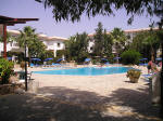The apartments are built around a central pool and garden area, with a friendly and pleasant pool bar.